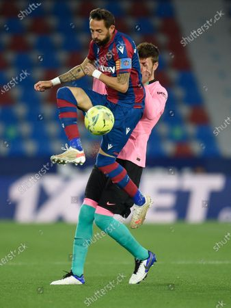 Gerard Pique of FC Barcelona and Jose Luis Morales of Levante UD