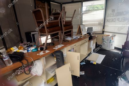 The closed Homeless Help Desk kiosk office, across the road from City Hall, is seen ransacked trough a tinted glass window, in Los Angeles. California Gov. Gavin Newsom is proposing $12 billion in new funding to get more people experiencing homelessness into housing