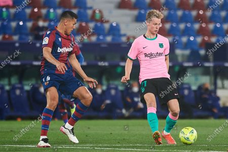 Stock Picture of Oscar Duarte of Levante UD and Frenkie de Jong of FC Barcelona during the La Liga Santander match between Levante and FC Barcelona at Estadio Ciutat de Valencia on 11 May, 2021 in Valencia, Spain
