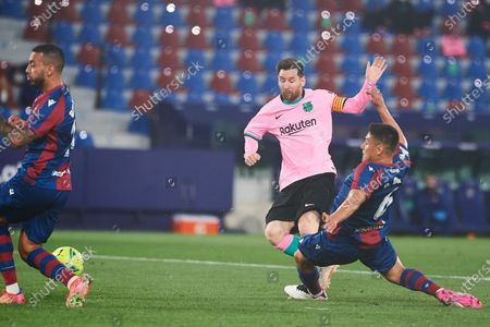 Lionel Messi of FC Barcelona and Oscar Duarte of Levante UD during the La Liga Santander match between Levante and FC Barcelona at Estadio Ciutat de Valencia on 11 May, 2021 in Valencia, Spain