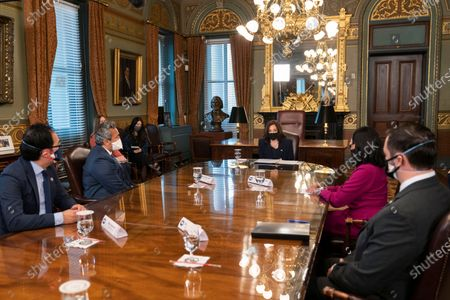 Vice President Kamala Harris speaks during a meeting with members of the Congressional Asian Pacific American Caucus, from left, Rep. Andy Kim, D-N.J.; Rep. Ami Bera, D-Calif.; Rep. Stephanie Murphy, D-Fla. and Del. Michael San Nicolas, D-Guam, at the Eisenhower Executive Office Building on the White House complex in Washington on