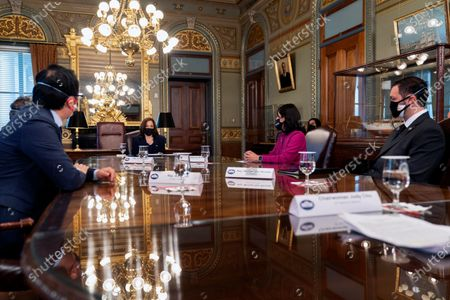 Vice President Kamala Harris speaks during a meeting with members of the Congressional Asian Pacific American Caucus, from left, Rep. Andy Kim, D-N.J.; Rep. Stephanie Murphy, D-Fla. and Del. Michael San Nicolas, D-Guam, at the Eisenhower Executive Office Building on the White House complex in Washington on