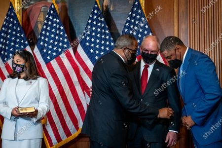 United States Representative-elect Troy Carter (Democrat of Louisiana), left, chats with Louisiana Gov. John Bel Edwards, center, and Cedric Richmond, Senior Advisor to the President and director of the White House Office of Public Engagement, right, prior to his ceremonial swearing-in by Speaker of the United States House of Representatives Nancy Pelosi (Democrat of California) at the US Capitol in Washington, DC,.