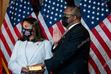 United States Representative-elect Troy Carter (Democrat of Louisiana), right, is joined by his wife Ana Carter during a ceremonial swearing-in by Speaker of the United States House of Representatives Nancy Pelosi (Democrat of California) at the US Capitol in Washington, DC,.