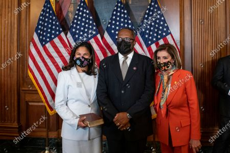 Speaker of the United States House of Representatives Nancy Pelosi (Democrat of California), right, poses for a photo with United States Representative Troy Carter (Democrat of Louisiana), center, and his wife Ana Carter, left, during a ceremonial swearing-in at the US Capitol in Washington, DC,.