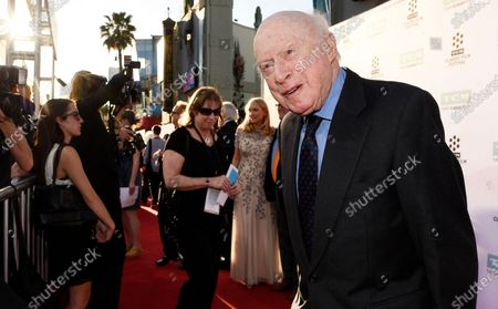 """Norman Lloyd poses before a 50th anniversary screening of the film """"The Sound of Music"""" at the opening night gala of the TCM Classic Film Festival on March 26, 2015, in Los Angeles. Lloyd, the distinguished stage and screen actor known for his role as a kindly doctor on TV's """"St. Elsewhere,"""" has died at 106. Manager Marion Rosenberg said the actor died, at his home in the Brentwood neighborhood of Los Angeles"""