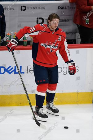 Washington Capitals center Nicklas Backstrom (19) warms up before an NHL hockey game against the Boston Bruins, in Washington