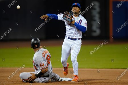 Stock Picture of New York Mets' Francisco Lindor throws to first base after forcing out Baltimore Orioles' Pedro Severino during the fifth inning of a baseball game, in New York. John Means was safe at first