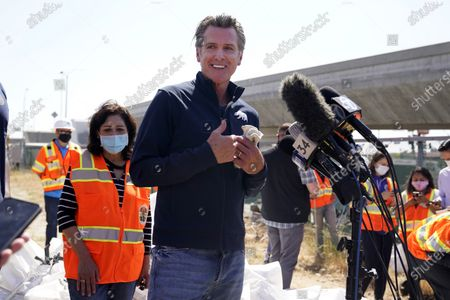 """California Gov. Gavin Newsom fields questions, in Los Angeles. Newsom on Tuesday proposed $12 billion in new funding to get more people experiencing homelessness in the state into housing and to """"functionally end family homelessness"""" within five years"""