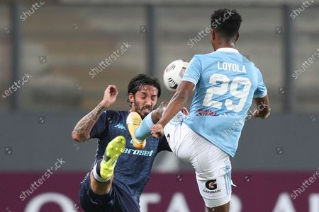 Stock Image of Ezequiel Schelotto of Argentina's Racing Club, left, and Nilson Loyola of Peru's Sporting Cristal battle for the ball during a Copa Libertadores soccer match in Lima, Peru