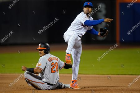 Stock Photo of New York Mets' Francisco Lindor, right, throws to first base after forcing out Baltimore Orioles' Pedro Severino during the fifth inning of a baseball game, in New York. John Means was safe at first base on the play