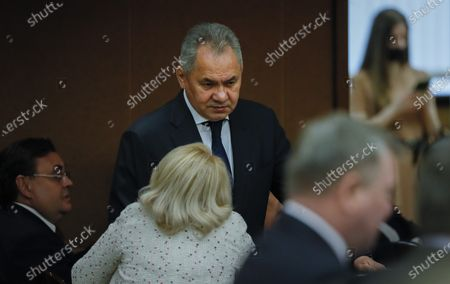 Russia's Defence Minister Sergei Shoigu (C) arrives to attend a plenary session at the State Duma in Moscow, Russia, 12 May 2021. Russian Prime Minister Mikhail Mishustin presents an annual report on the Russian Government's performance in 2020 at the plenary session of the Russian State Duma.