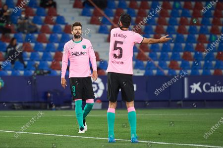 Gerard Pique and Sergio Busquets of FC Barcelona