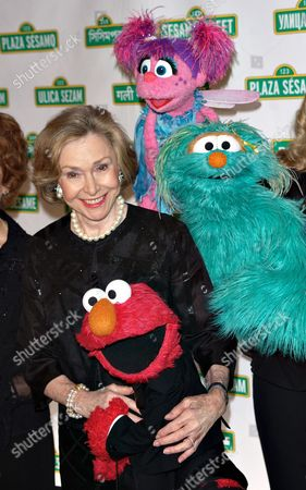 Joan Ganz Cooney and Sesame Street Characters