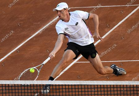 John Millman of Australia in action against Matteo Berrettini of Italy during their men's singles second round match at the Italian Open tennis tournament in Rome, Italy, 12 May 2021.