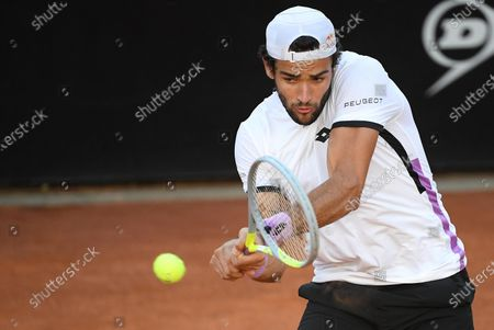 Matteo Berrettini of Italy in action against John Millman of Australia during their men's singles second round match at the Italian Open tennis tournament in Rome, Italy, 12 May 2021.