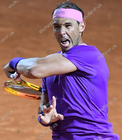 Rafael Nadal of Spain in action against Jannik Sinner of Italy during their men's singles second round match at the Italian Open tennis tournament in Rome, Italy, 12 May 2021.