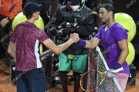 Rafael Nadal (R) of Spain and Jannik Sinner of Italy after their men's singles second round match at the Italian Open tennis tournament in Rome, Italy, 12 May 2021.