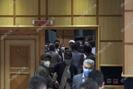 Former president Mahmoud Ahmadinejad arrives a press center to read his statement after registering as a candidate for June 18, presidential elections, in the Iranian Interior Ministry building in central Tehran on May 12, 2021.