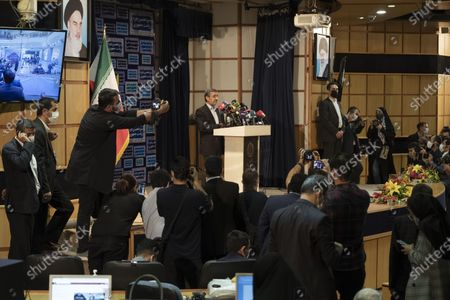 Former president Mahmoud Ahmadinejad (C) reads his statement while attending a press center after registering as a candidate for June 18, presidential elections, in the Iranian Interior Ministry building in central Tehran on May 12, 2021.