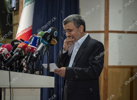Former president Mahmoud Ahmadinejad reads his statement while attending a press center after registering as a candidate for June 18, presidential elections, in the Iranian Interior Ministry building in central Tehran on May 12, 2021.
