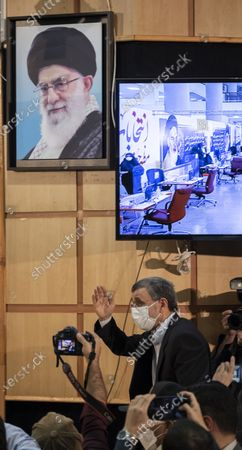Former president Mahmoud Ahmadinejad gestures while attending a press center to read his statement after registering as a candidate for June 18, presidential elections, in the Iranian Interior Ministry building in central Tehran on May 12, 2021.