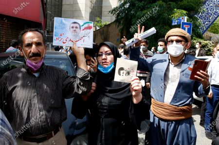 Supporters of former President Mahmoud Ahmadinejad gather in front of  the Interior Ministry while he registers his name as a candidate for the June 18, presidential elections at elections headquarters