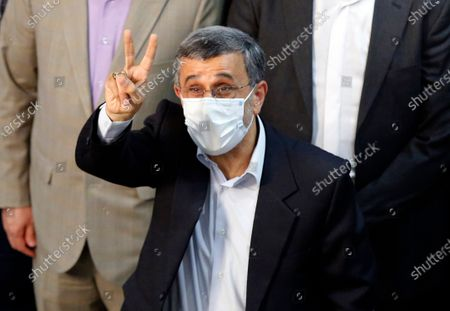 Stock Photo of Former President Mahmoud Ahmadinejad flashes a victory sign while registering his name as a candidate for the June 18, presidential elections at elections headquarters of the Interior Ministry