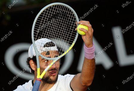 Stock Image of Italy's Matteo Berrettini serves the ball to Australia's John Millman during their match at the Italian Open tennis tournament, in Rome