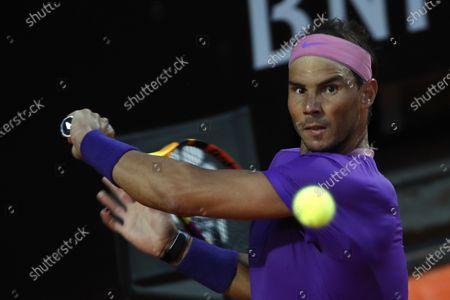 Spain's Rafael Nadal returns the ball to Italy's Jannik Sinner at the Italian Open tennis tournament, in Rome