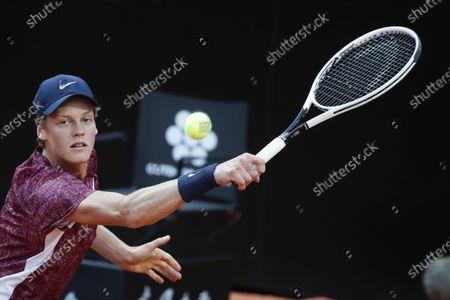 Italy's Jannik Sinner returns the ball to Spain's Rafael Nadal at the Italian Open tennis tournament, in Rome