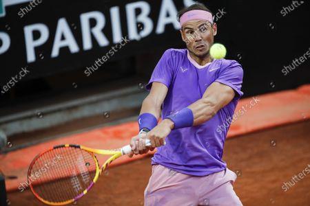 Stock Photo of Spain's Rafael Nadal returns the ball to Italy's Jannik Sinner at the Italian Open tennis tournament, in Rome