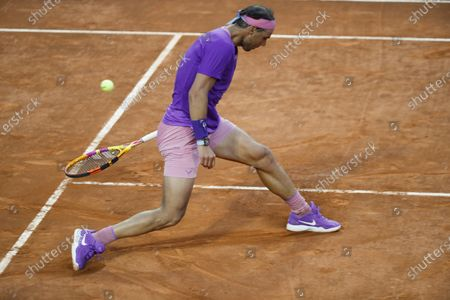 Stock Image of Spain's Rafael Nadal misses a ball during the match against Italy's Jannik Sinner at the Italian Open tennis tournament, in Rome