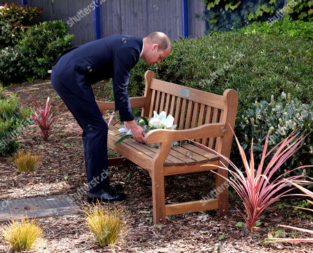 Stock Image of Prince William laying a wreath on the bench dedicated to Sergeant Ratana at the centre.  Prince William will visit Croydon Custody Centre on Wednesday 12th May to pay tribute to Sergeant Matt Ratana, who was tragically shot and killed whilst on duty at the Centre on Friday 25th September, 2020. The Duke will meet a number of Sergeant Ratana?s colleagues to pass on his condolences and hear some of their memories of working with him. Sergeant Ratana worked in the Metropolitan Police Service (MPS) for nearly 30 years, having joined the Met Police in 1991. He worked in a number of boroughs and teams during his time in the Met Police, and transferred to Croydon in 2015 where he worked as a response and neighbourhood officer before becoming a custody sergeant. During the visit, His Royal Highness will take part in a moment of reflection for Sergeant Ratana, after privately meeting his partner.