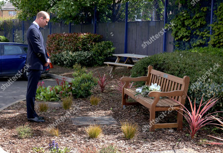 Stock Photo of Prince William pausing after laying a wreath on the bench dedicated to Sergeant Ratana at the centre.  Prince William will visit Croydon Custody Centre on Wednesday 12th May to pay tribute to Sergeant Matt Ratana, who was tragically shot and killed whilst on duty at the Centre on Friday 25th September, 2020. The Duke will meet a number of Sergeant Ratana?s colleagues to pass on his condolences and hear some of their memories of working with him. Sergeant Ratana worked in the Metropolitan Police Service (MPS) for nearly 30 years, having joined the Met Police in 1991. He worked in a number of boroughs and teams during his time in the Met Police, and transferred to Croydon in 2015 where he worked as a response and neighbourhood officer before becoming a custody sergeant. During the visit, His Royal Highness will take part in a moment of reflection for Sergeant Ratana, after privately meeting his partner.