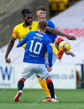 Stock Photo of Jay Emmanuel-Thomas of Livingston controls the ball from Jack Simpson and Steven Davis of Rangers during the Scottish Premiership match at the Tony Macaroni Arena, Livingston.