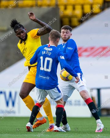 Stock Image of Jay Emmanuel-Thomas of Livingston controls the ball from Jack Simpson and Steven Davis of Rangers during the Scottish Premiership match at the Tony Macaroni Arena, Livingston.
