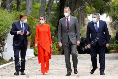 Spain's King Felipe VI (2-R) and Queen Letizia (L) arrive at the home of poet Francisco Brines (unseen), accompanied by Valencia's regional President, Ximo Puig (L), and Spanish Culture Minister, Jose Manuel Rodriguez Uribes, in the town of Oliva, eastern Spain, 12 May 2021. The Spanish royal couple handed over 2020 Cervantes Prize to Spanish poet Francisco Brines in his home due to the delicate state of Brines' health amid coronavirus pandemic despite the awarding ceremony, traditionally held each 23 April in the town of Alcala de Henares.