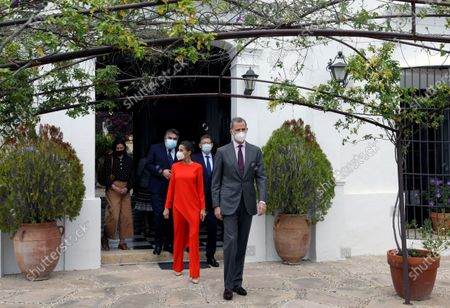 King Felipe VI (R) and Queen Letizia (C) of Spain leave the home of poet Francisco Brines (unseen), accompanied by Valencia's regional President, Ximo Puig (2R, bacground), and Spanish Culture Minister, Jose Manuel Rodriguez Uribes (2L, background), in the town of Oliva, eastern Spain, 12 May 2021. The Spanish royal couple handed over 2020 Cervantes Prize to Spanish poet Francisco Brines in his home due to the delicate state of Brines' health amid coronavirus pandemic despite the awarding ceremony, traditionally held each 23 April in the town of Alcala de Henares.