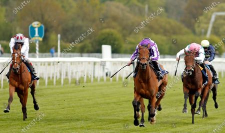 SNOWFALL (Ryan Moore) beats NOON STAR (right) and TEONA (left) in The Tattersalls Musidora Stakes York