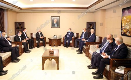 Hosting Syrian Foreign Minister Faisal Mikdad (C-R) and his Iranian counterpart Mohammad Javad Zarif (C-L) meet for talks in Damascus, Syria, 12 May 2021. In a statement to reporters upon his his arrival, the Iranian Minister was quoted by the official Syrian News Agency SANA as saying that 'the criminal acts of the Zionist entity that have escalated since International Jerusalem Day and the unprecedented events that took place in the Al-Aqsa Mosque and the occupied territories and the bombing of Gaza have created very deteriorating conditions in the region'  adding that Syria 'as one of the leading countries in the axis of resistance, has a very important role in this field.'