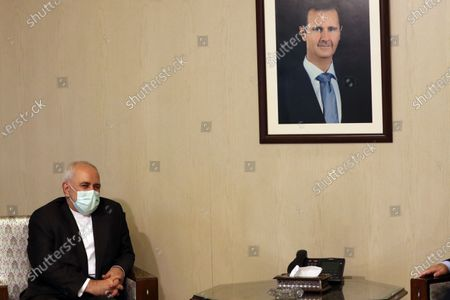 Iranian Foreign Minister Mohammad Javad Zarif (C-L) meets his Syrian counterpart Faisal Mikdad (unseen) for talks in Damascus, Syria, 12 May 2021. In a statement to reporters upon his his arrival, the Iranian Minister was quoted by the official Syrian News Agency SANA as saying that 'the criminal acts of the Zionist entity that have escalated since International Jerusalem Day and the unprecedented events that took place in the Al-Aqsa Mosque and the occupied territories and the bombing of Gaza have created very deteriorating conditions in the region'  adding that Syria 'as one of the leading countries in the axis of resistance, has a very important role in this field.'