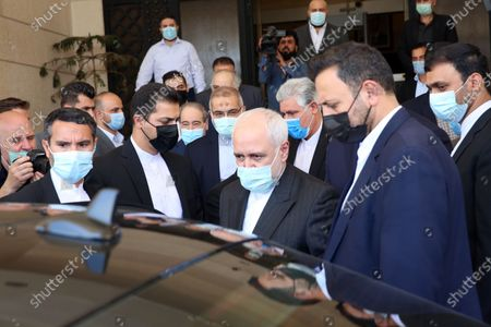 Iranian Foreign Minister Mohammad Javad Zarif (C) departs from a meeting with his Syrian counterpart Faisal Mikdad (unseen) in Damascus, Syria, 12 May 2021. In a statement to reporters upon his his arrival, the Iranian Minister was quoted by the official Syrian News Agency SANA as saying that 'the criminal acts of the Zionist entity that have escalated since International Jerusalem Day and the unprecedented events that took place in the Al-Aqsa Mosque and the occupied territories and the bombing of Gaza have created very deteriorating conditions in the region'  adding that Syria 'as one of the leading countries in the axis of resistance, has a very important role in this field.'