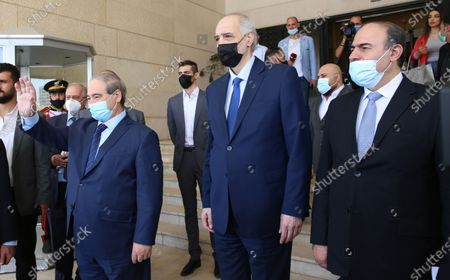 Syrian Foreign Minister Faisal Mikdad (L) and his assistant Bashar Jaafari (C) bid farewell to visiting Iranian Foreign Minister Mohammad Javad Zarif (unseen) after a meeting in Damascus, Syria, 12 May 2021. In a statement to reporters upon his his arrival, the Iranian Minister was quoted by the official Syrian News Agency SANA as saying that 'the criminal acts of the Zionist entity that have escalated since International Jerusalem Day and the unprecedented events that took place in the Al-Aqsa Mosque and the occupied territories and the bombing of Gaza have created very deteriorating conditions in the region'  adding that Syria 'as one of the leading countries in the axis of resistance, has a very important role in this field.'