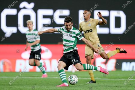 (210512) - LISBON, May 12, 2021 (Xinhua) - Paulinho (C) of Sporting CP lives with Reggie Cannon of Boavista FC during a Portuguese League football match at Jose Alvalade stadium in Lisbon, Portugal on May 11, 2021.