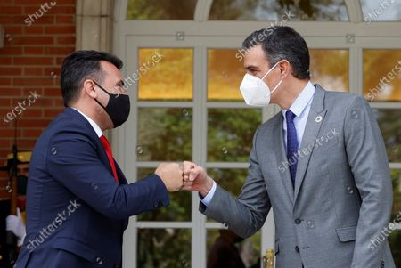 Spanish Prime Minister, Pedro Sanchez (R), greets the Prime Minister of North Macedonia Zoran Zaev (L), shortly before both leaders hold a meeting at La Moncloa Palace, in Madrid, Spain, 12 May 2021.