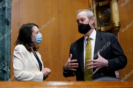 Sen. Maria Cantwell, D-Wash., left, talks with Sen. Mike Crapo, R-Idaho, right, before the start of a hearing with United States Trade Representative Katherine Tai before the Senate Finance Committee on Capitol Hill in Washington, . The hearing was to examine President Joe Biden's 2021 trade policy agenda