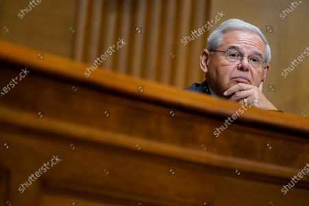 Sen. Bob Menendez, D-N.J., listens to United States Trade Representative Katherine C. Tai as she testifies before the Senate Finance Committee on Capitol Hill in Washington, during a hearing to examine President Joe Biden's 2021 trade policy agenda
