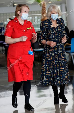 Camilla, Duchess of Cornwall walks with Michelle Johnson, Director of Nursing during a visit on International Nurse Day to Whittington Hospital in London