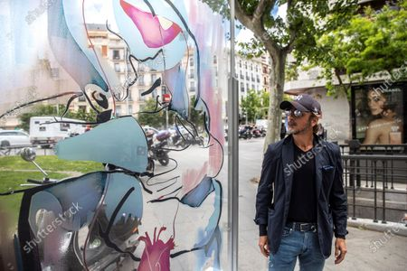 Portuguese artist Pedro Andrade looks at one of his methacrylate artworks in Madrid, Spain, 12 May 2021. These artworks, symbolizing the missing hugs during the ongoing coronavirus pandemics, have been placed in several places of Madrid.